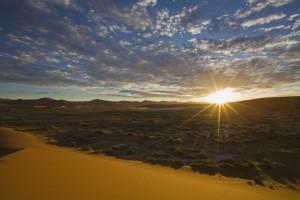 Africa, Namibia, Sun rising over Namib Desert